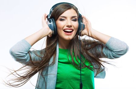 Photo pour Woman with headphones listening music .Music teenager girl dancing against isolated white background - image libre de droit