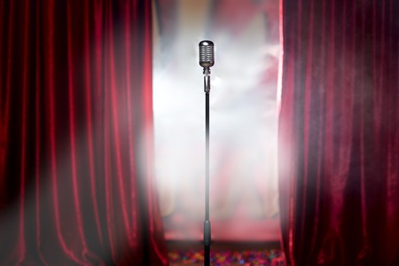 Photo pour the microphone in front of red curtain on an empty stage after the concert, smoke - image libre de droit
