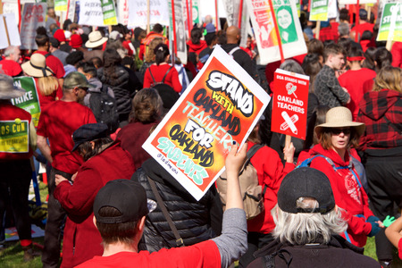 Oakland, CA - February 22, 2019: Unidentified participants at Oakland teachers strike day 2 rally at DeFremery Park, then marching downtown. Fighting for smaller class sizes and bigger paychecks.