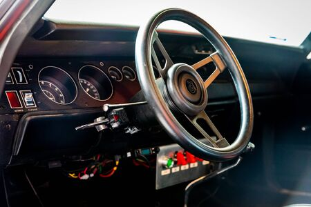 Photo pour A Muscle Car Interior with Bright Switches and Buttons - image libre de droit
