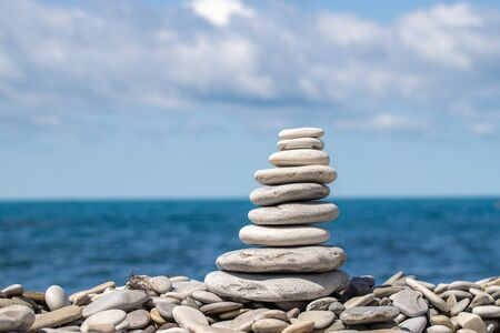 Photo pour A stack of colored pebbles on the background the sky and sea - image libre de droit