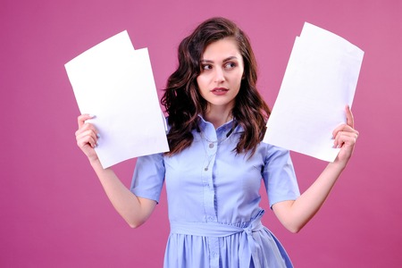 Photo for Young caucasian brunette woman holding paper over pink background scared in shock with a surprise face, afraid and excited with fear expression - Royalty Free Image