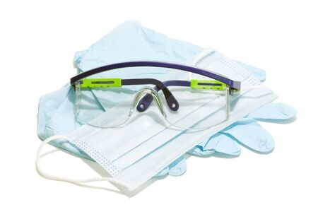 Photo pour Gloves, mask and goggles for personal protection on white background. - image libre de droit