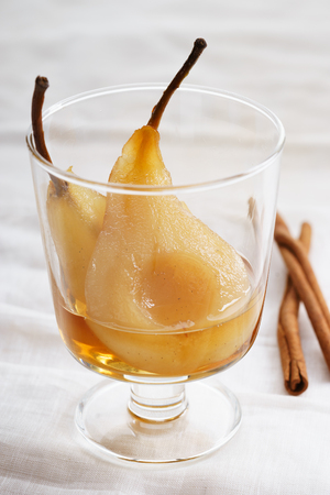 sweet poached pear cut half in a glass for dessert