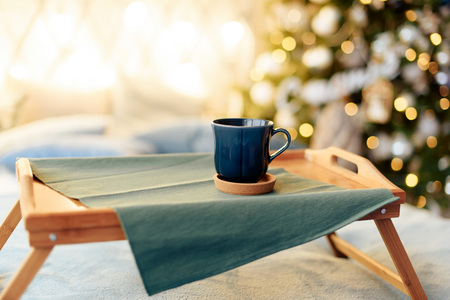 Photo for cups with tea on the background of the Christmas tree 1 - Royalty Free Image