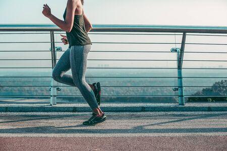 Foto de Fast professional runner on the bridge stock photo - Imagen libre de derechos