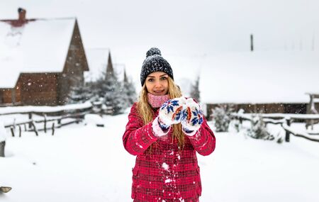 young girl in glove smiling outdoor, snow winter cold weather christmas, outside, woman in red jacket or clothes