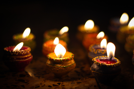 Photo for earthen diya lamp lighting with candles on the occasion of diwali and sandhi pujo - Royalty Free Image