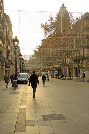 BARCELONA, CATALONIA, SPAIN - DECEMBER 14, 2011: Street in Ciutat Vella Old Town early morning in Barcelona