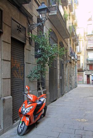 BARCELONA, CATALONIA, SPAIN - DECEMBER 12, 2011: Parked motorbike in the street in Ciutat Vella Old Town in Barcelona
