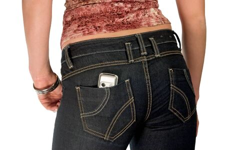 silver mobile phone in jeans pocket