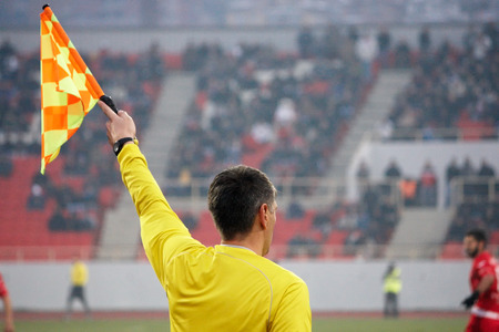 Assistant football referee, soccer referee in the stadium