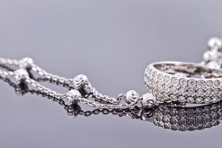 engagement silver ring with precious stones and fine silver chain