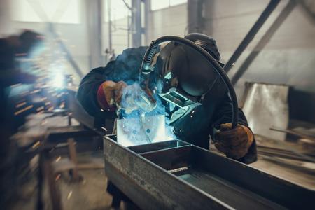Foto für Welder performs welding work of metal structures in a complex spatial position semi-automatic welding - Lizenzfreies Bild