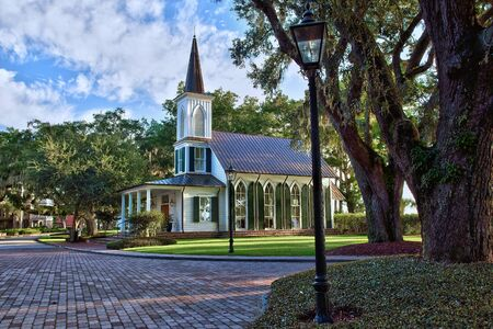 Charming southern community in South Carolina with gas lit lamps, moss filled trees, and beautiful country church.