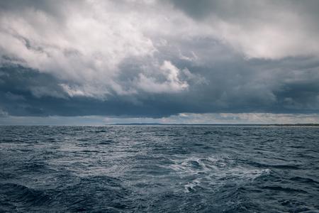 Foto de Gloomy weather at sea with rain clouds - Imagen libre de derechos