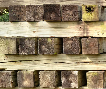 A stack of four by four inches lumber with growth rings