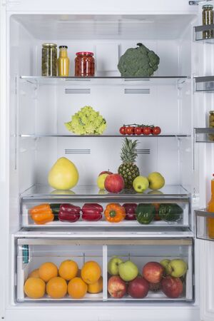 Photo for Open fridge full of fresh fruits and vegetables, healthy food background, organic nutrition, health care, dieting concept - Royalty Free Image