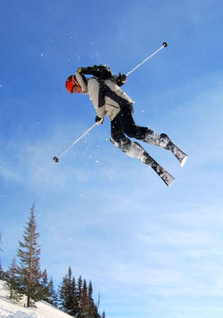 Skier jumping freestyle high in the air