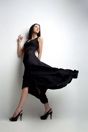 Photo for High fashion shot of elegant woman in a black long fluttering dress. - Royalty Free Image