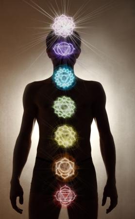 Man silhouette standing, chakra symbols