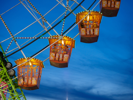 Seville, Spain - April 23, 2015: Seville, Spain - April 23, 2015: Ferris wheel illuminated at night in april fair of Seville. Detail of ferris wheel illuminated at night in the april fair of Seville. Calle el Infierno: (Hell Street) rides areas adjacent t