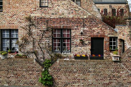 Photo pour The detail of the brick houses in Bruges in Belgium. The typical colorful facades on historic houses. - image libre de droit