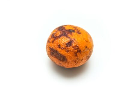 Photo pour A picture of an ordinary old and dry mandarin. It has a quite dry pulp inside. Not very good to eat. - image libre de droit