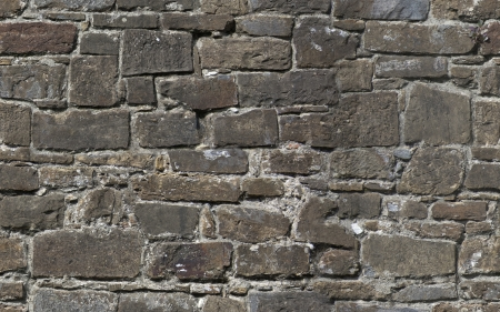 Seamless texture of old stone wall of fortress
