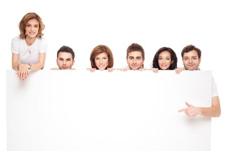 Photo pour group of smiling friends advertising blanck banner  - image libre de droit