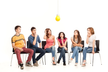 group of friends pondering over a light bulb