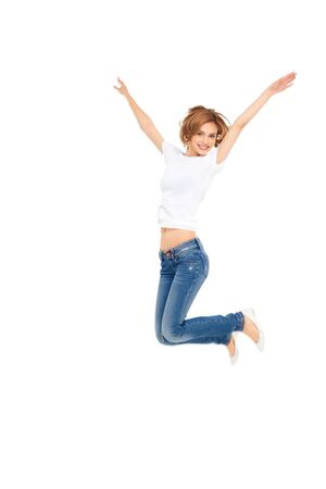 young casual woman jumping exited with hands in the air
