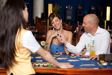 man offering young gorgeous woman two blackjack chips