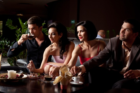 romantic glamourous couples sitting at coffee and dessert