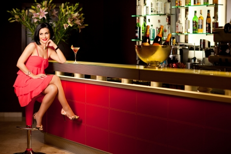 beautiful woman red dress bar counter smile