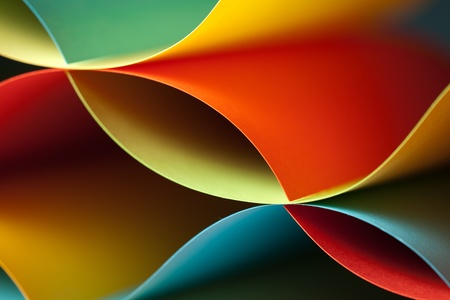 graphic abstract image of colorful origami pattern made of curved sheets of paper