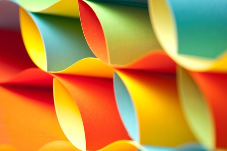 Foto de graphic abstract image of colorful origami pattern made of curved sheets of paper - Imagen libre de derechos