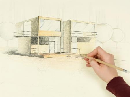 Foto de woman's hand drawing architectural perspective of modern house - Imagen libre de derechos