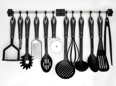 kitchen utensils hanging white background