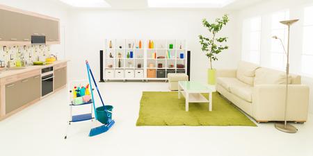Photo pour cleaning supplies in clean modern living room - image libre de droit