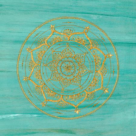 Golden mandala on turquoise background