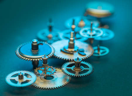 Photo for Close up of Steampunk Clock Cogs on blue background - Royalty Free Image