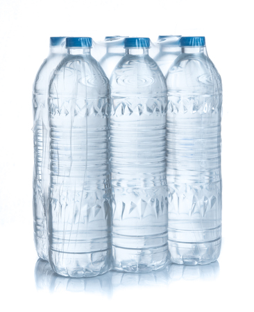 Photo pour Plastic bottles water in wrapped package on white - image libre de droit