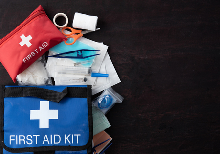 Foto de First aid medical kit on wood - Imagen libre de derechos