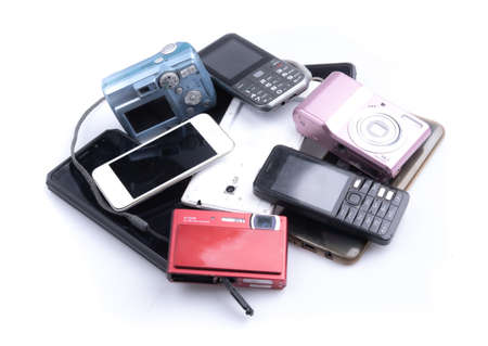 Photo pour Pile of mobile phone and camera on white background, Reuse and Recycle concept - image libre de droit