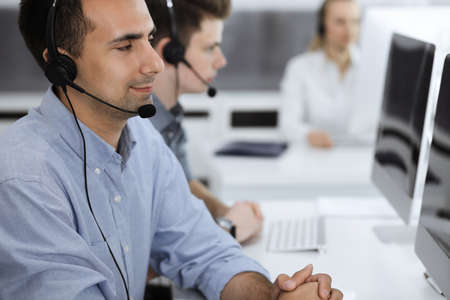 Photo for Call center. Group of casual dressed operators at work. Adult businessman in headset at customer service office. Telesales in business - Royalty Free Image