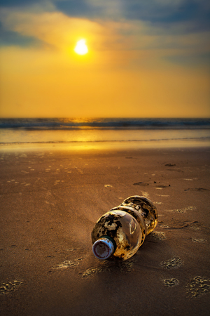 Plastic bottle on sea shore