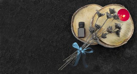 Photo for Aromatic oil, candle and flowers on a dark background, spa - Royalty Free Image