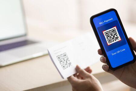 Photo pour Using Smartphone Scanning QR Code for bill payment option - image libre de droit