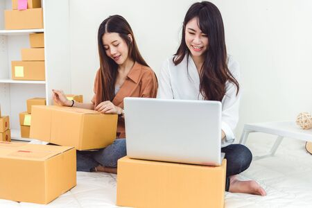 Photo pour Young Asian woman startup small business entrepreneur SME distribution warehouse with parcel mail box. Owner home office concept. Online marketing and product packaging and delivery service. - image libre de droit